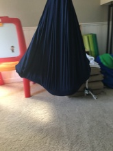 Wilson's very own spacial swing at home. The swing provides vestibular input, increasing body awareness. The pressure provides a cocoon-like environment that has a calming effect. After moving or resting in the Lycra swing, children can feel more alert, relaxed and energized.